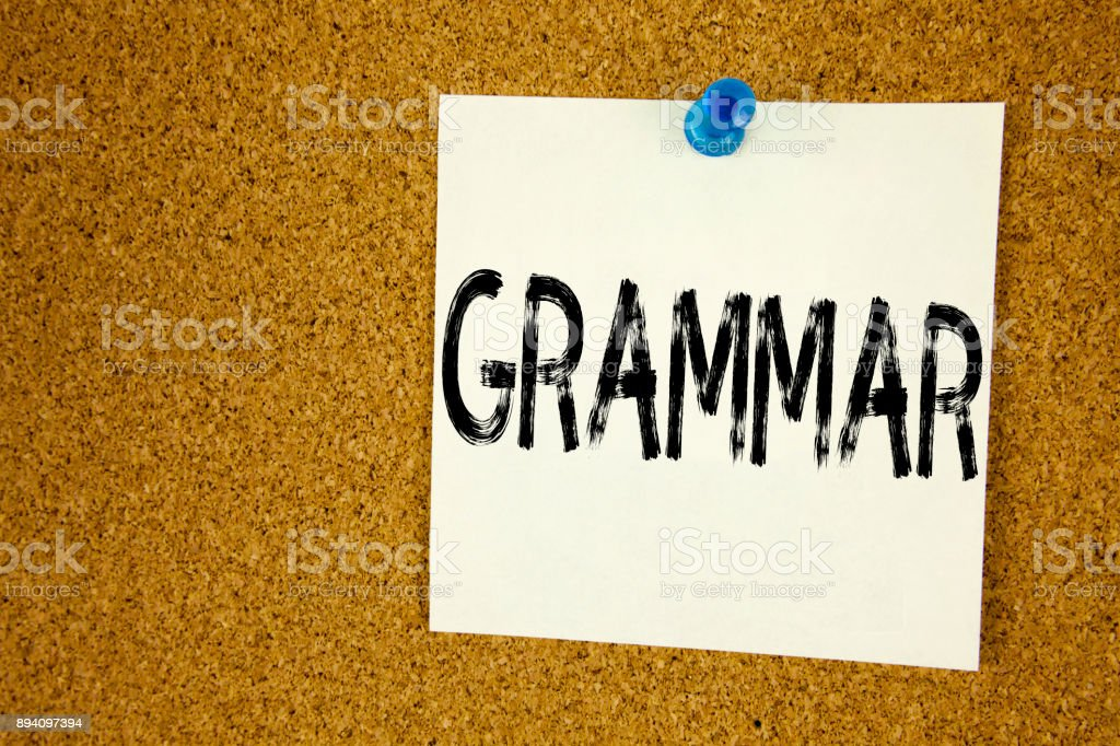 Conceptual hand writing text caption inspiration showing Grammar. Business concept for   The Basic Rules of Syntax Grammatical Language written on sticky note, reminder cork background with copy space stock photo