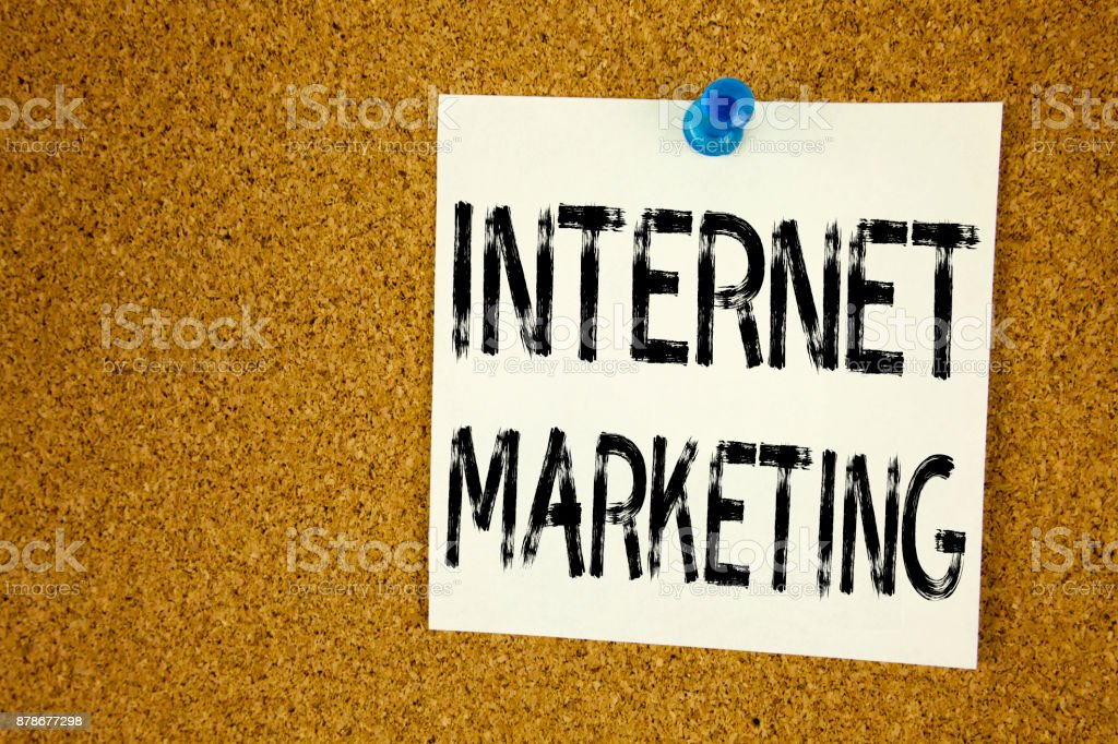 Conceptual hand writing text caption inspiration showing Internet Marketing . Business concept for Technology Strategy Design written on sticky note, reminder cork background with copy space stock photo