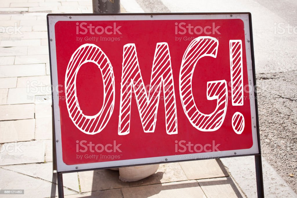 Conceptual hand writing text caption inspiration showing OMG Oh My God. Business concept for Surprise Humor written on announcement road sign with background and copy space stock photo