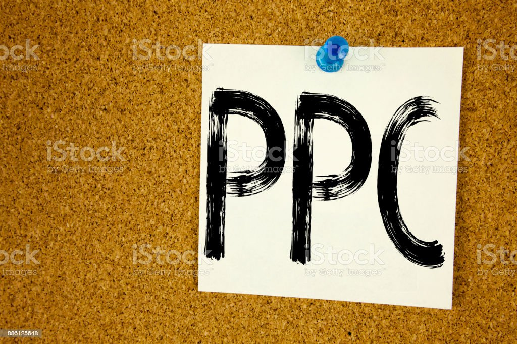 Conceptual hand writing text caption inspiration showing PPC - Pay per Click. Business concept for Internet SEO Money written on sticky note, reminder cork background with copy space stock photo