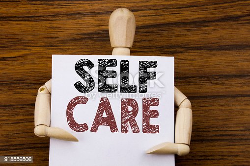 1175869940istockphoto Conceptual hand writing text caption inspiration showing Self Care. Business concept for Taking caring for own Health written on sticky note paper on the wooden background. Holding by the sculpture. 918556506