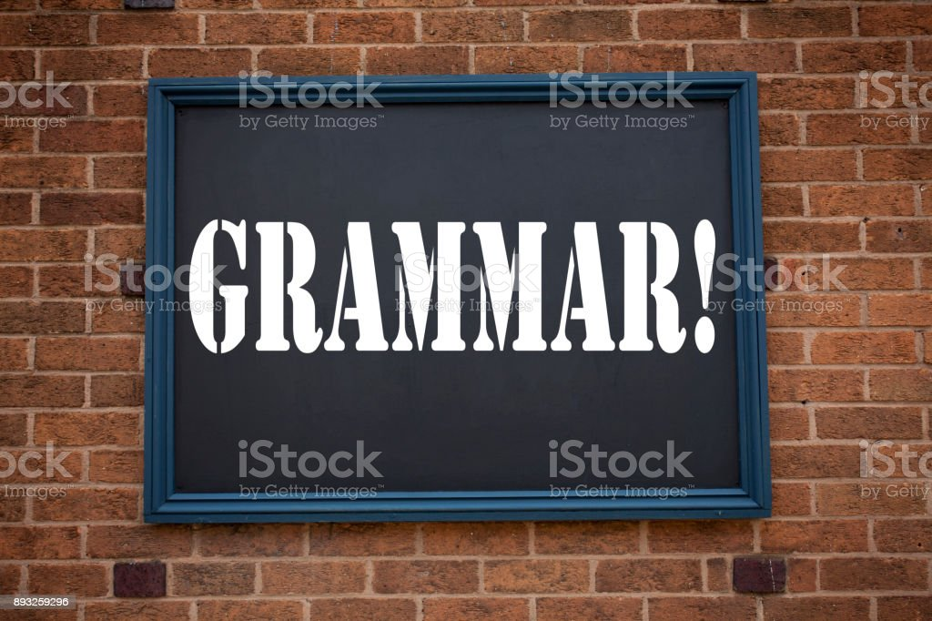 Conceptual hand writing text caption showing announcement Grammar. Business concept for   The Basic Rules of Syntax Grammatical Language written on frame old brick background and copy space stock photo