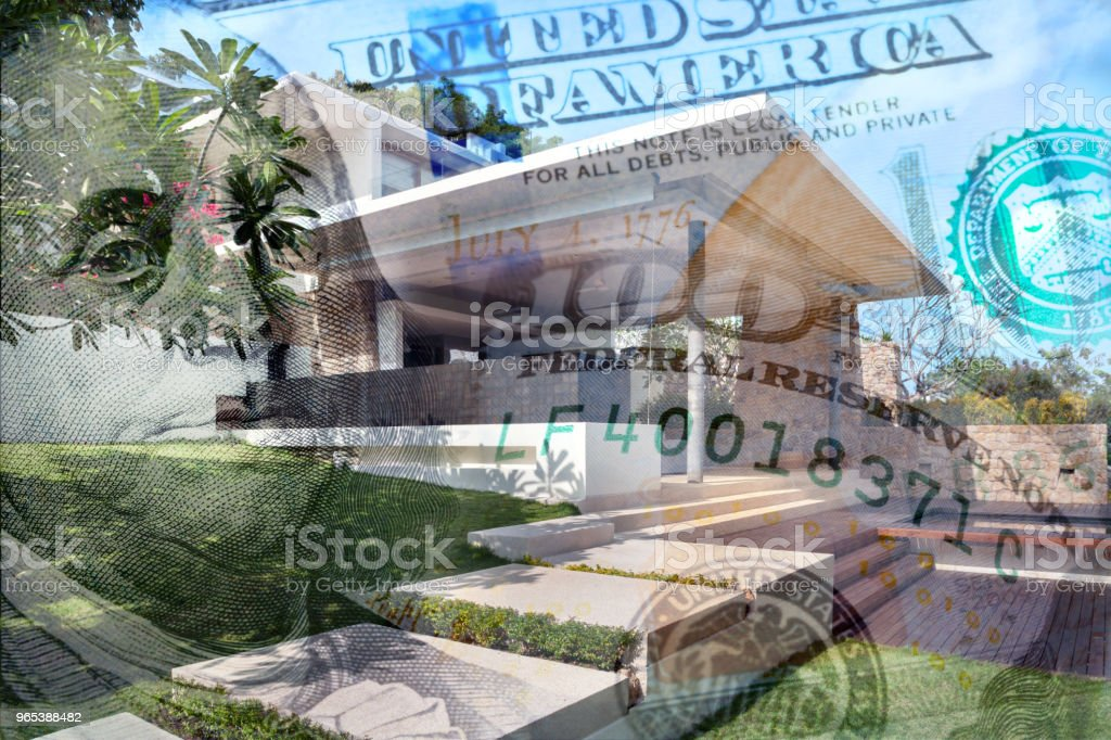 Conceptual Image Of A Home With Money Depicting Housing Prices royalty-free stock photo
