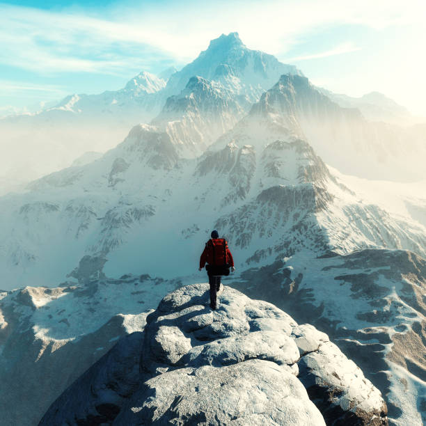 conceptual image of a man hiker with backpack in front of a mountain - coraggio foto e immagini stock
