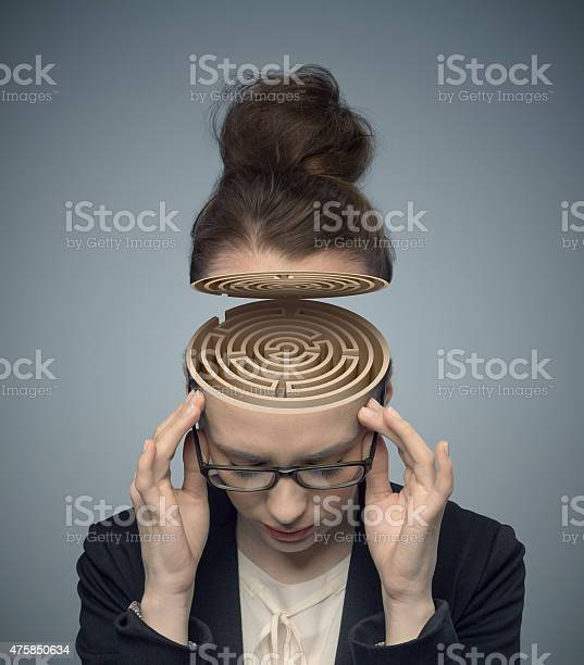 Conceptual image of a maze in the womans brain picture id475850634?b=1&k=6&m=475850634&s=612x612&h=w fmstmpdy1ja89lapzduqzqn0toaudu6 fsxbqrf6o=