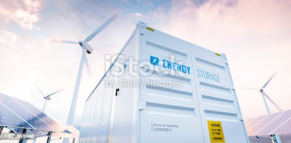 istock Conceptual image of a modern battery energy storage system with wind turbines and solar panel power plants in background. 3d rendering 1301598466