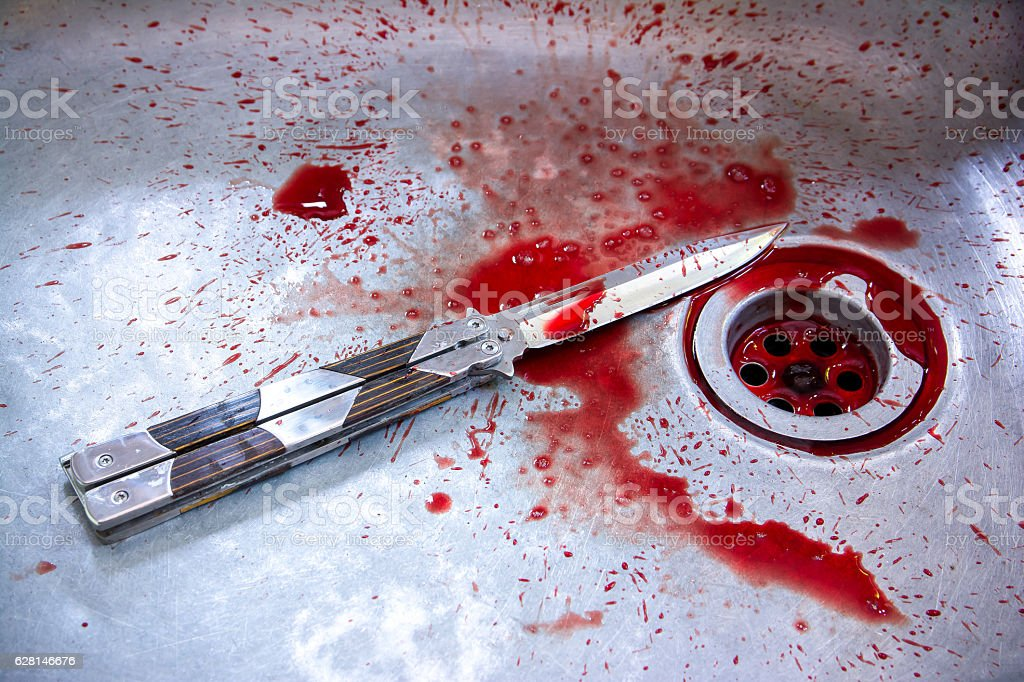Conceptual image of a sharp knife with blood in sink stock photo