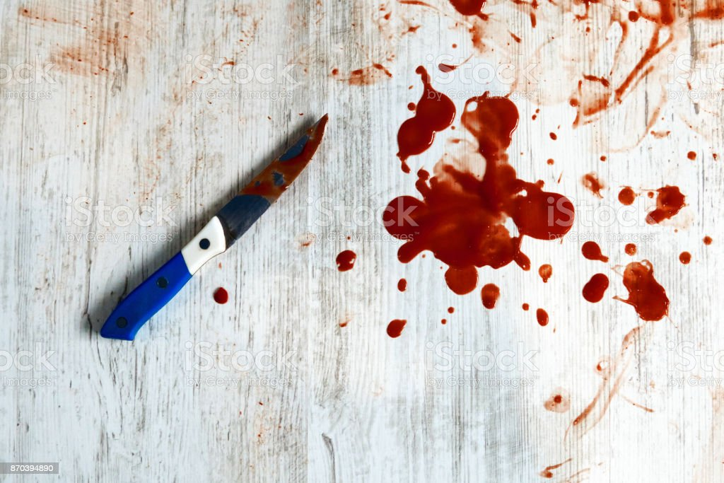 Conceptual image of a sharp knife with blood stock photo