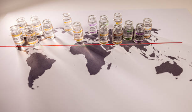Conceptual image of a world globe map for the global SARS/COVID pandemic, with vaccine hoarding, restricting equal access to vaccines across the world, seen as a moral failure resulting in inequality, stock photo