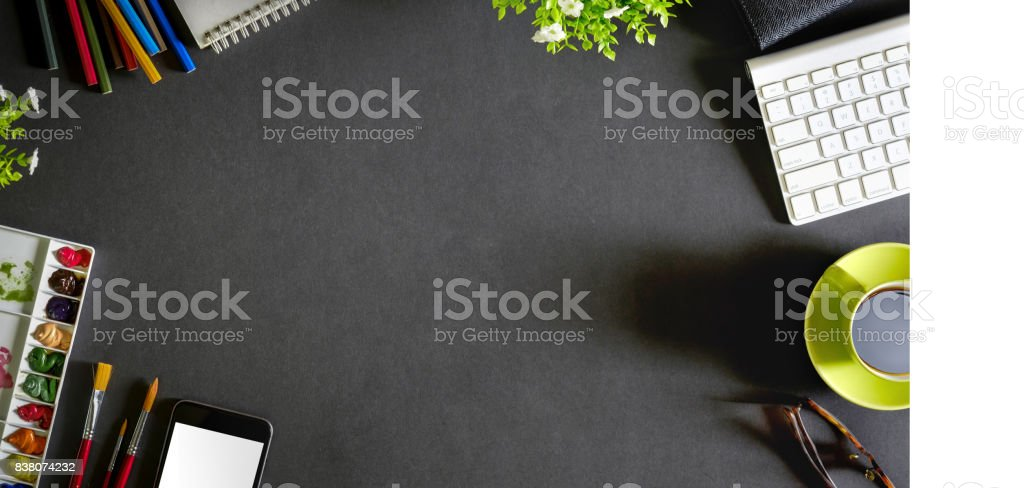 Conceptual image of Artist graphic designer workplace dark surface top view. stock photo