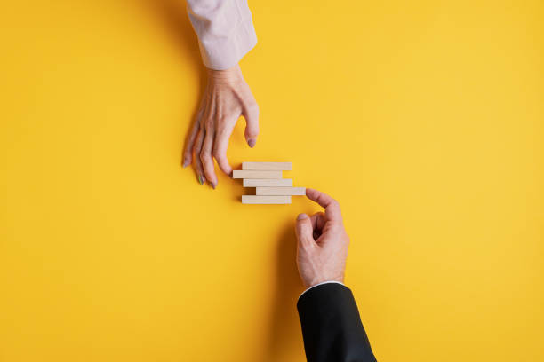 Conceptual image of business stability and teamwork stock photo
