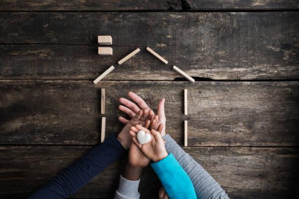 Konzeptbild von Familienliebe, Zusammengehörigkeit und Sicherheit – Foto