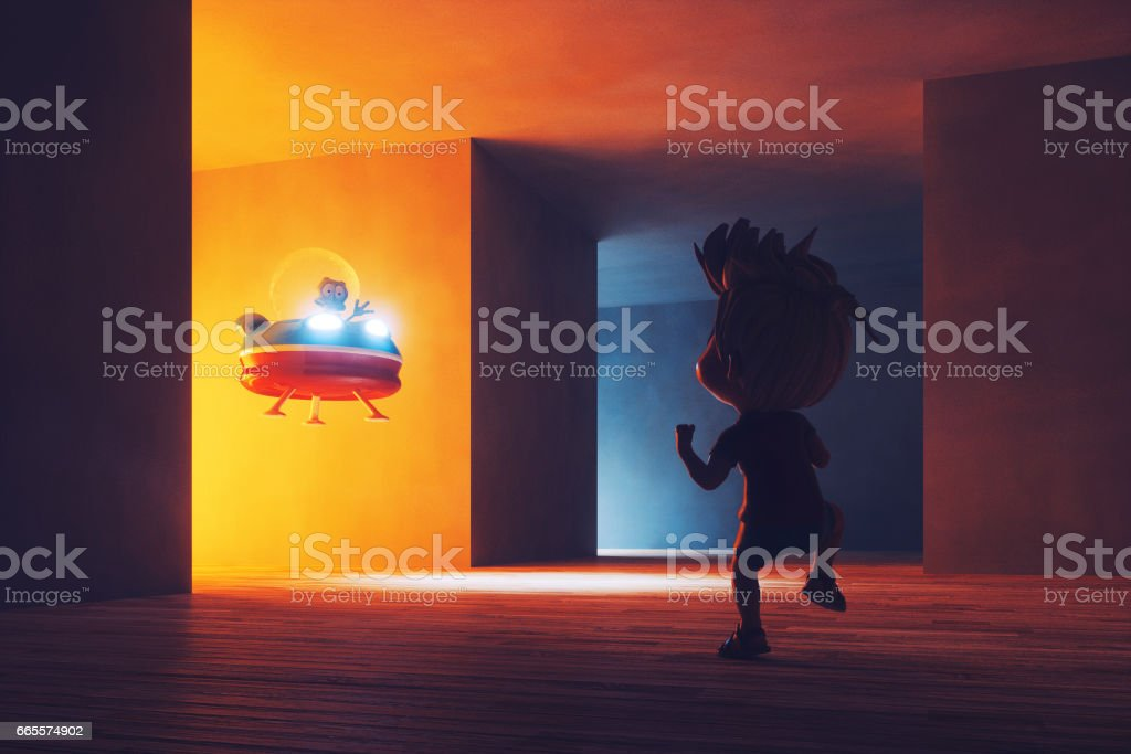 Conceptual image of kid discovering alien UFO stock photo
