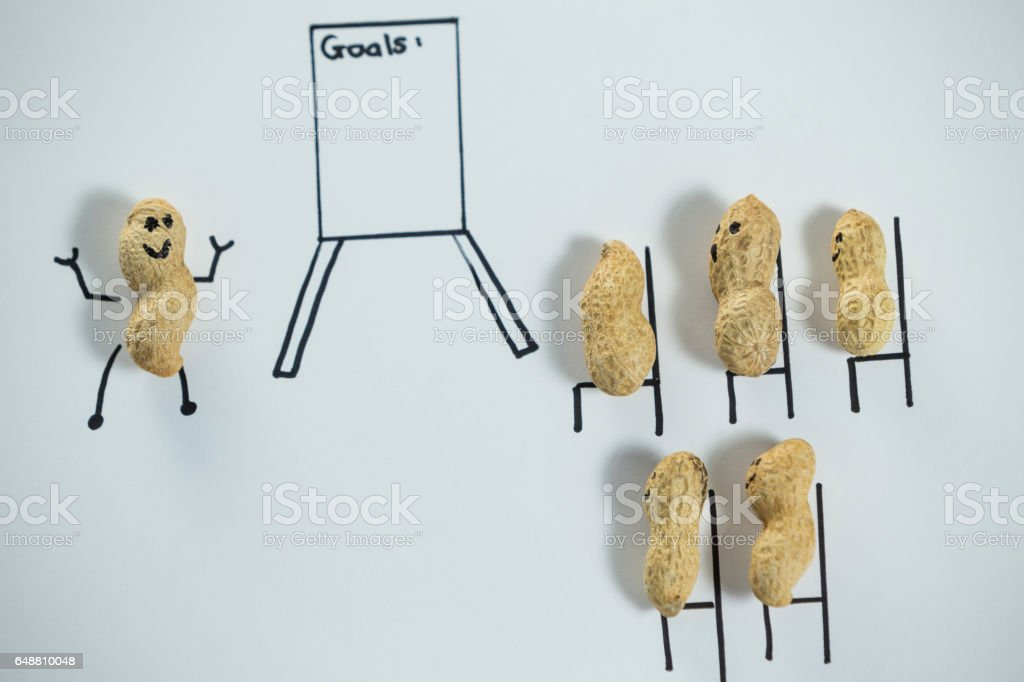 Conceptual image of peanut figurines attending a official meeting stock photo