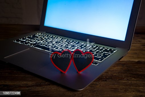 istock Conceptual image of text Love you in wood blocks on computer with mood romantic screen light background in Valentines day internet connection technology online dating and communication concept. 1093722498