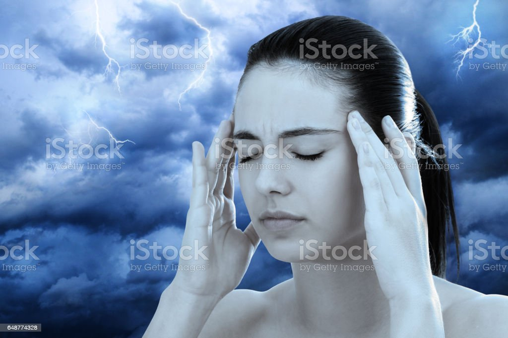 Conceptual image of woman meditating against stormy background. stock photo
