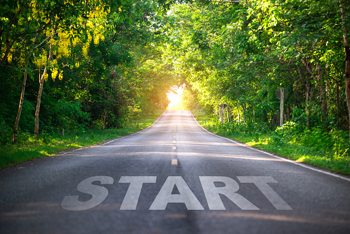 Conceptual image with word start on asphalt road ,Start line on the highway concept for business planning, strategy and challenge or career path, opportunity and change