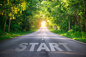 istock Conceptual image with word start on asphalt road ,Start line on the highway concept for business planning, strategy and challenge or career path, opportunity and change 1144354092