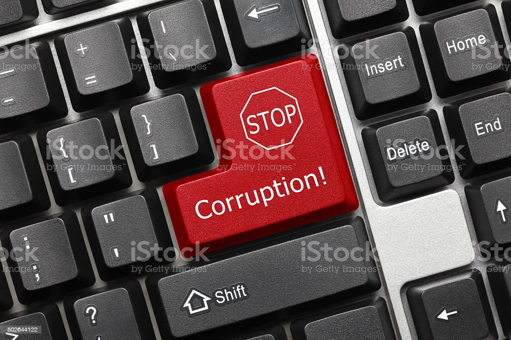 Conceptual keyboard - Corruption (red key) stock photo