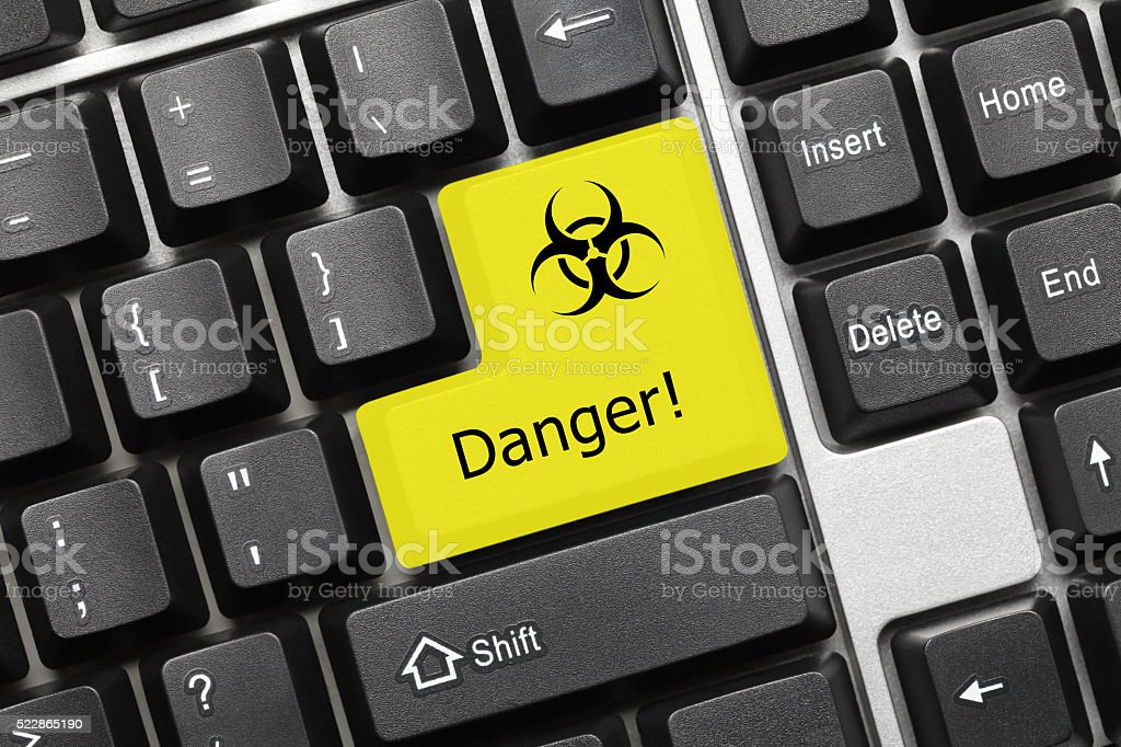 Conceptual keyboard - Danger (yellow key with biohazard symbol) stock photo