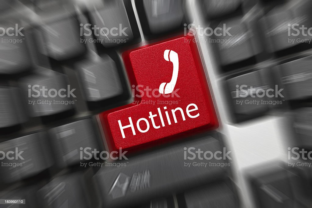 Conceptual keyboard - Hotline (red key). Zoom effect royalty-free stock photo