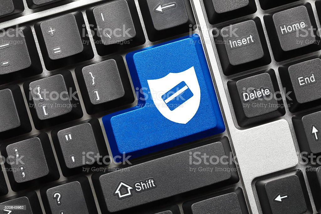Conceptual keyboard - Key with shield and credit card symbols stock photo