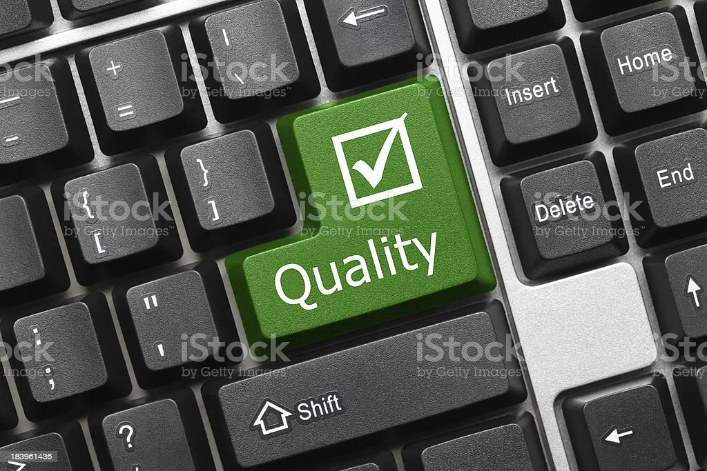 Conceptual keyboard - Quality (green key) stock photo