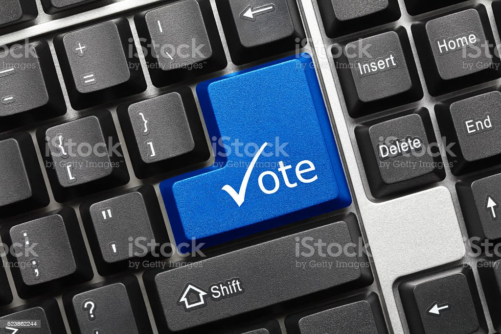 Conceptual keyboard - Vote (blue key with check symbol) stock photo