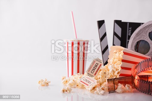 istock Conceptual objects of cinema with white background front 959115056