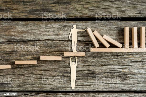 Conceptual Paper Man Helping Other With Support Stock Photo - Download Image Now