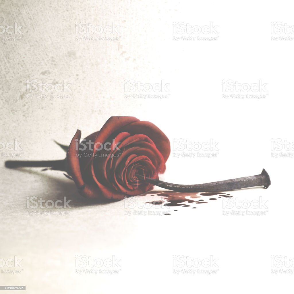 Conceptual photo of a struck and pierced love stock photo