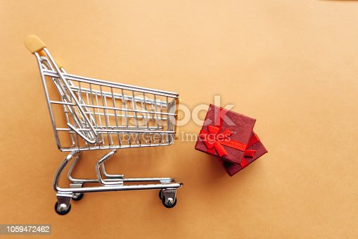 1136804881 istock photo Conceptual photo of Christmas sales or gift shopping. 1059472462