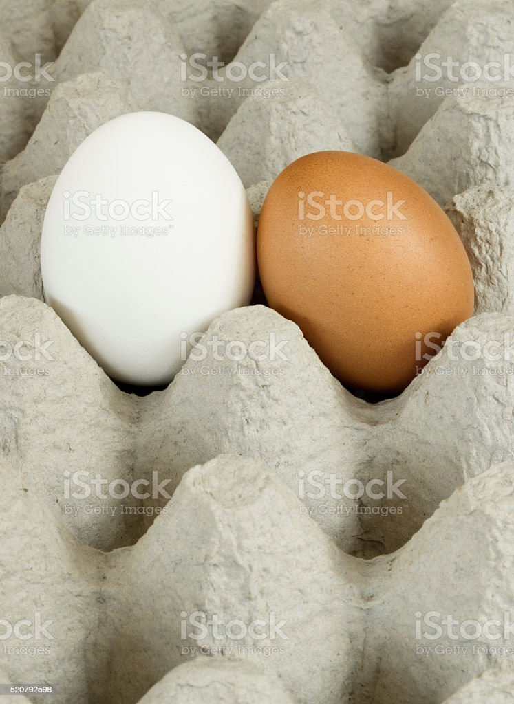 Conceptual photo of two eggs together stock photo
