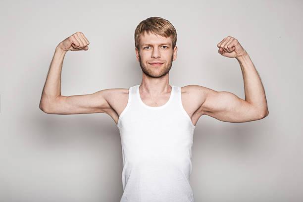 conceptual retrato de un hombre zurdo - hombres grandes musculosos fotografías e imágenes de stock