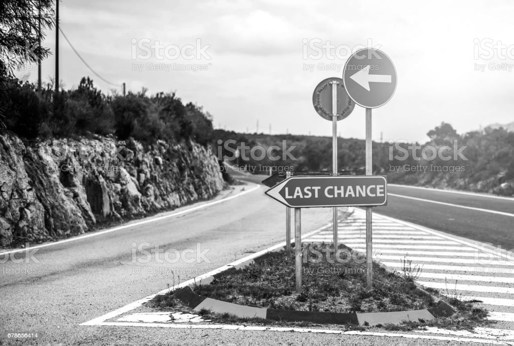 Conceptual road sign with motivation stock photo