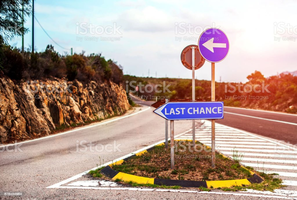 Conceptual road sign with motivation text stock photo
