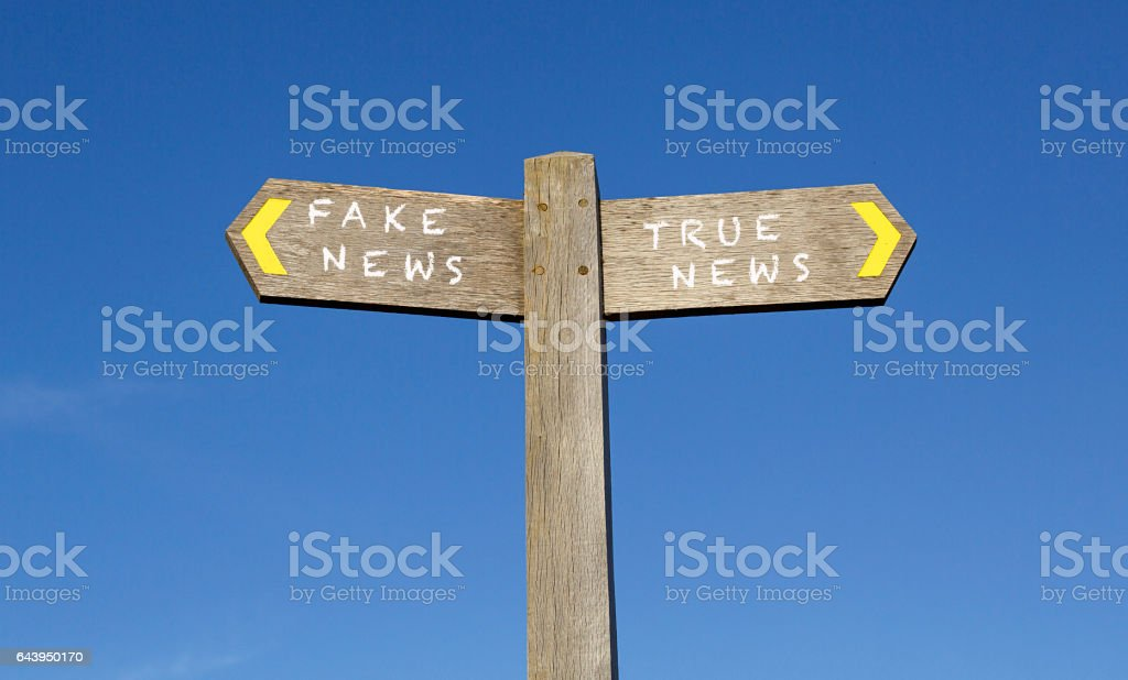 Conceptual Signpost - Fake and True News stock photo