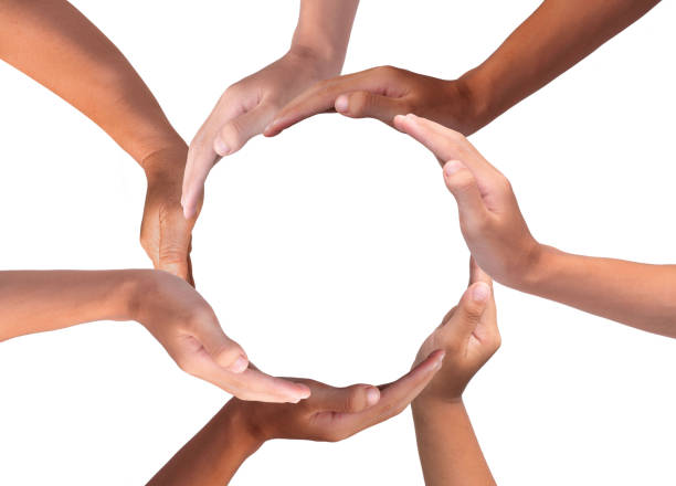 Conceptual symbol of multiracial human hands making a circle on white background with a copy space in the middle stock photo
