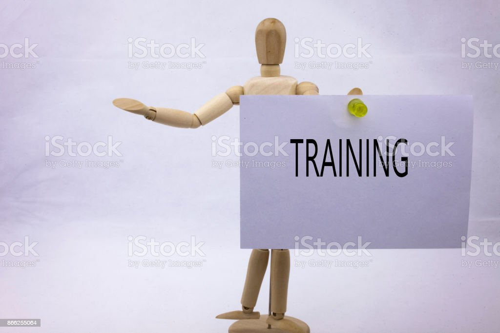 A Conceptual yellow Hand writing caption inscription written sticky note with word Training With black ink on a sticky note pinned to a hand of a sculpture stock photo