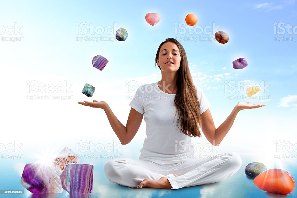 Conceptual yoga with gemstones. stock photo