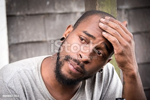 istock concerned afro caribbean man 695667354