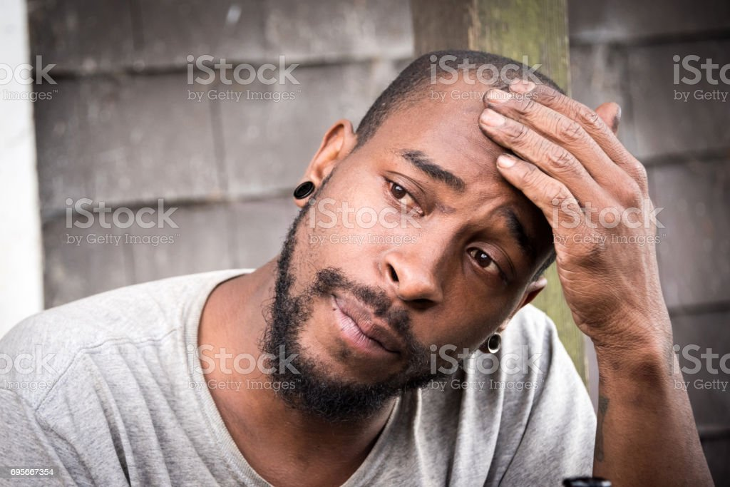 concerned afro caribbean man stock photo