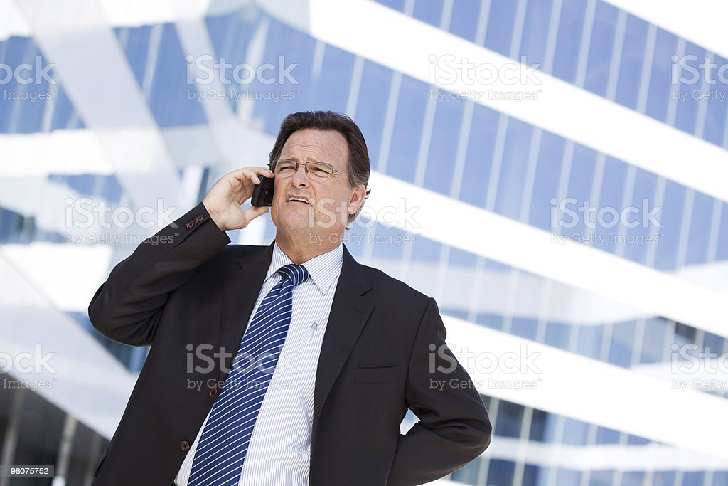 Concerned Businessman Talks on His Cell Phone royalty-free stock photo