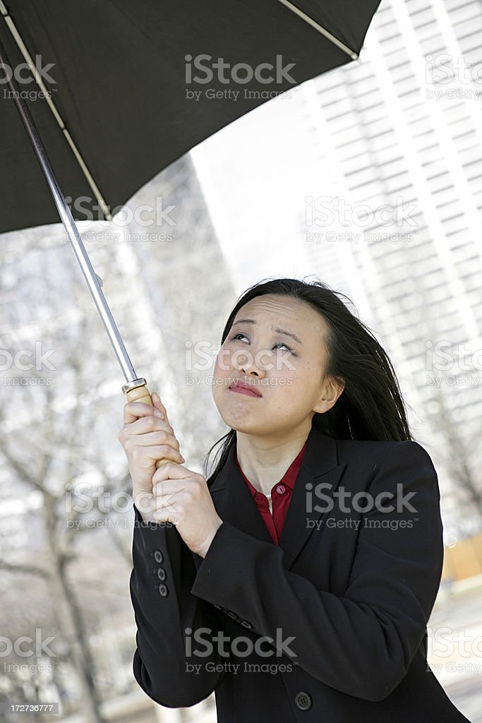 Concerned Businesswoman Holding Umbrella royalty-free stock photo