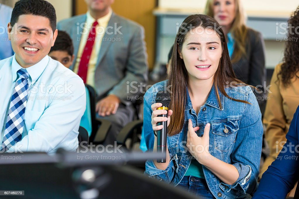 Concerned citizen asks a mayoral candidate a question during meeting stock photo