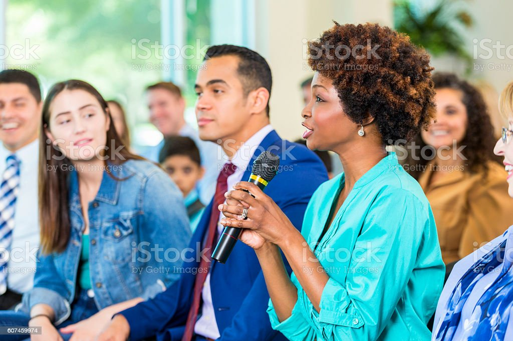 Concerned constituent asks politician a question during meeting stock photo