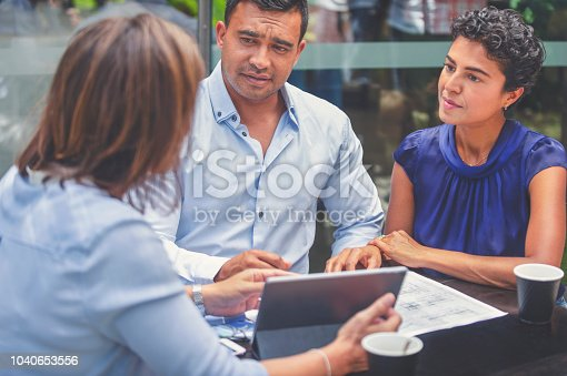 istock Concerned couple having a business meeting with a financial advisor. 1040653556