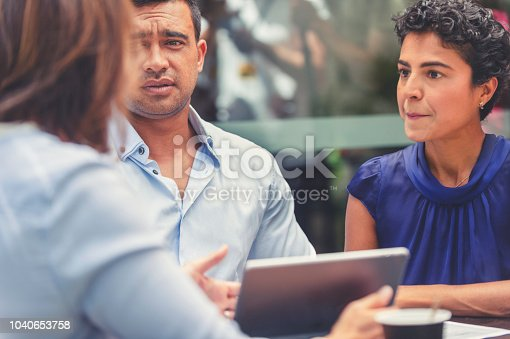 1178695243 istock photo Concerned couple having a business meeting with a financial advisor. 1040653758