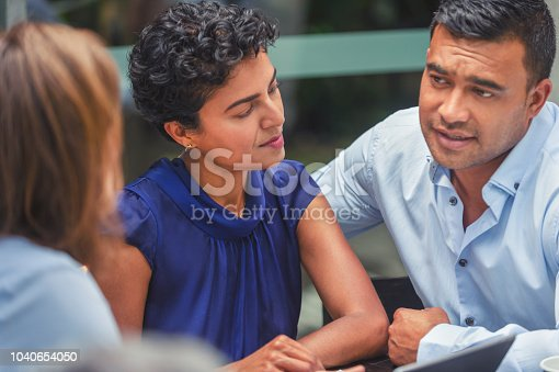 1178695243 istock photo Concerned couple having a business meeting with a financial advisor. 1040654050
