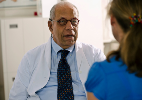 Concerned Doctor Meeting With His Patient Stock Photo - Download Image Now
